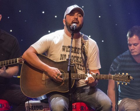 CHICAGO, ILLINOIS - NOVEMBER 09:  Tyler Farr and band performs at the CBS RADIOs second annual Stars and Strings concert at The Chicago Theatre on November 9, 2016 in Chicago, Illinois.  (Photo by Barry Brecheisen/WireImage)