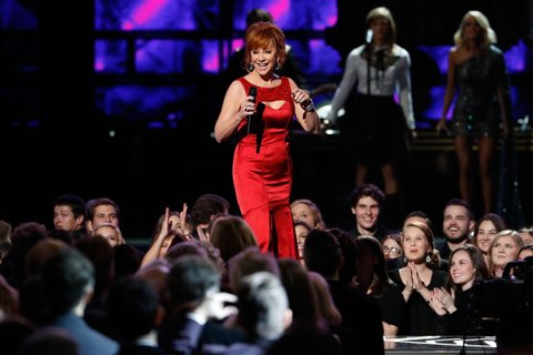 NASHVILLE, TN - NOVEMBER 02:  Reba McEntire performs onstage during the 50th annual CMA Awards at the Bridgestone Arena on November 2, 2016 in Nashville, Tennessee.  (Photo by aylor Hill/Getty Images)