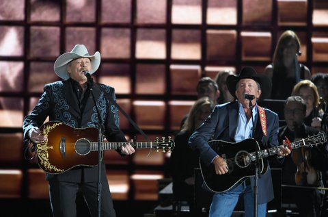 NASHVILLE, TN - NOVEMBER 02:  Alan Jackson and George Strait perform onstage at the 50th annual CMA Awards at the Bridgestone Arena on November 2, 2016 in Nashville, Tennessee.  (Photo by Erika Goldring/FilmMagic)