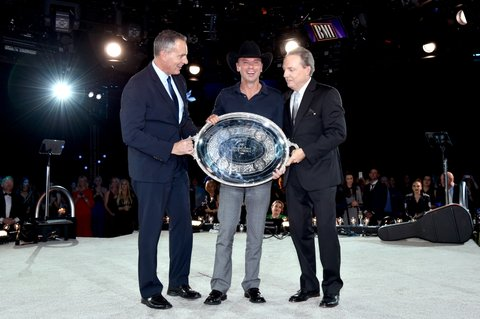 NASHVILLE, TN - NOVEMBER 01:  President and CEO of BMI Mike O'Neill, and Vice President, Writer/Publisher Relations at BMI Jody Williams present the Presidents Award to Kenny Chesney onstage at the 64th Annual BMI Country Awards at BMI on November 1, 2016 in Nashville, Tennessee.  (Photo by John Shearer/Getty Images for BMI)