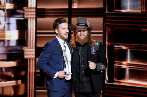 NASHVILLE, TN - NOVEMBER 02:  T.J. Osborne and John Osborne of musical duo Brothers Osborne accept award onstage at the 50th annual CMA Awards at the Bridgestone Arena on November 2, 2016 in Nashville, Tennessee.  (Photo by Erika Goldring/FilmMagic)