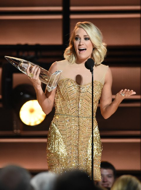 NASHVILLE, TN - NOVEMBER 02:  Carrie Underwood accepts award onstage at the 50th annual CMA Awards at the Bridgestone Arena on November 2, 2016 in Nashville, Tennessee.  (Photo by Erika Goldring/FilmMagic)