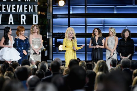 NASHVILLE, TN - NOVEMBER 02:  (L-R) Kacey Musgraves, Reba McEntire, Jennifer Nettles, Dolly Parton, Martina McBride, Carrie Underwood, Lily Tomlin onstage at the 50th annual CMA Awards at the Bridgestone Arena on November 2, 2016 in Nashville, Tennessee.  (Photo by Erika Goldring/FilmMagic)