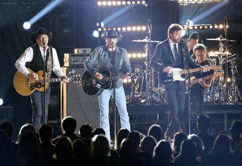NASHVILLE, TN - NOVEMBER 02: Kix Brooks of Brooks and Dunn, Jason Aldean, and Ronnie Dunn of Brooks and Dunn perform onstage at the 50th annual CMA Awards at the Bridgestone Arena on November 2, 2016 in Nashville, Tennessee.  (Photo by Terry Wyatt/WireImage)