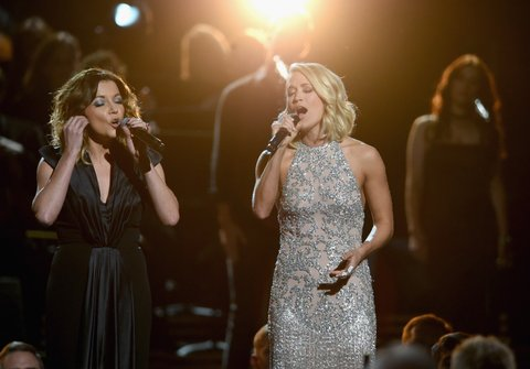 NASHVILLE, TN - NOVEMBER 02:  Martina McBride and Carrie Underwood perform for Dolly Parton onstage at the 50th annual CMA Awards at the Bridgestone Arena on November 2, 2016 in Nashville, Tennessee.  (Photo by Erika Goldring/FilmMagic)