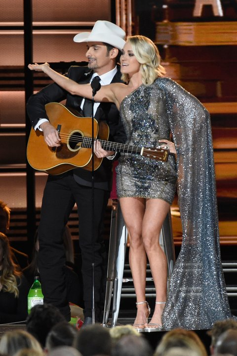 NASHVILLE, TN - NOVEMBER 02:  Co-hosts Brad Paisley and Carrie Underwood perform onstage at the 50th annual CMA Awards at the Bridgestone Arena on November 2, 2016 in Nashville, Tennessee.  (Photo by Gustavo Caballero/Getty Images)