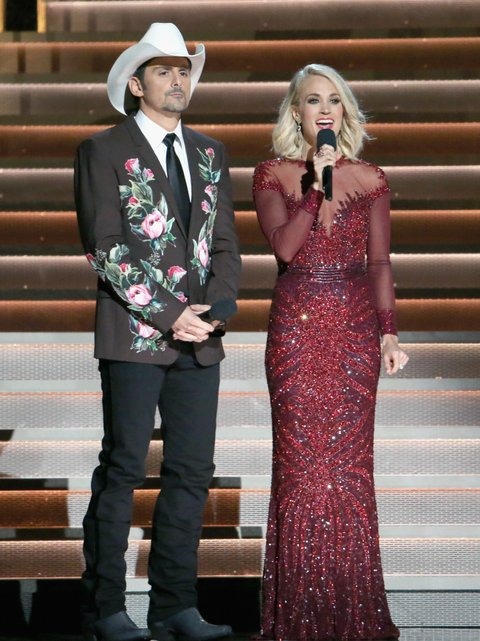 NASHVILLE, TN - NOVEMBER 02:  Hosts Brad Paisley and Carrie Underwood speak onstage at the 50th annual CMA Awards at the Bridgestone Arena on November 2, 2016 in Nashville, Tennessee.  (Photo by Terry Wyatt/WireImage)