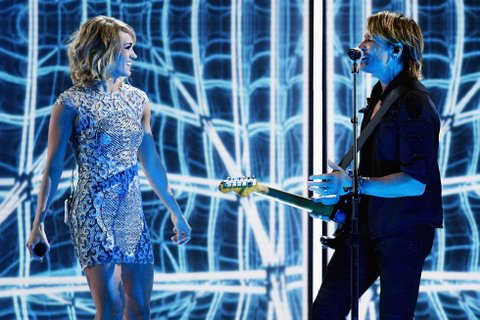 LOS ANGELES, CA - FEBRUARY 12:  Recording artists Carrie Underwood (L) and Keith Urban perform onstage during The 59th GRAMMY Awards at STAPLES Center on February 12, 2017 in Los Angeles, California.  (Photo by Kevin Winter/Getty Images for NARAS)