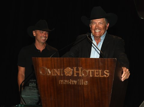 NASHVILLE, TN - FEBRUARY 27:  Kenny Chesney and George Strait present Tony Martell Lifetime Entertainment Achievement Award to Louis Messina at the T.J. Martell Foundation 9th Annual Nashville Honors Gala at Omni Hotel on February 27, 2017 in Nashville, Tennessee.  (Photo by Rick Diamond/Getty Images for T.J. Martell Foundation)