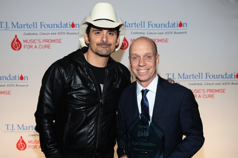 NASHVILLE, TN - FEBRUARY 27: Brad Paisley and Lifetime Humanitarian Award recipient Scott Hamilton attend the T.J. Martell Foundation 9th Annual Nashville Honors Gala at Omni Hotel on February 27, 2017 in Nashville, Tennessee.  (Photo by Terry Wyatt/Getty Images for T.J. Martell Foundation)