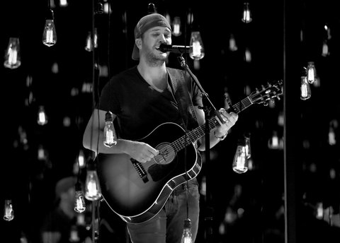 LAS VEGAS, NV - APRIL 01:  (EDITORS NOTE: This image has been converted to black and white.)  Singer Luke Bryan rehearses onstage during for the 52nd Academy Of Country Music Awards at T-Mobile Arena on April 1, 2017 in Las Vegas, Nevada.  (Photo by Kevin Winter/ACMA2017/Getty Images for ACM)