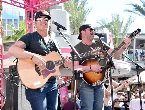 LAS VEGAS, NV - APRIL 01:  Musicians Jerrod Niemann (L) and Lee Brice perform onstage at the ACM Pool Party For A Cause on April 1, 2017 in Las Vegas, Nevada.  (Photo by Frazer Harrison/Getty Images for ACM)