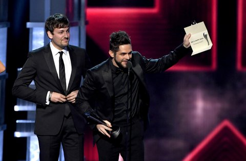 LAS VEGAS, NV - APRIL 02:  Songwriter Joe Spargur (L) and recording artist Thomas Rhett accept the Song of the Year award for 'Die a Happy Man' onstage during the 52nd Academy Of Country Music Awards at T-Mobile Arena on April 2, 2017 in Las Vegas, Nevada.  (Photo by Ethan Miller/Getty Images)