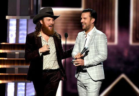 LAS VEGAS, NV - APRIL 02:  Recording artists John Osborne (L) and T.J. Osborne of music group Brothers Osborne accept the Vocal Duo of the Year award onstage during the 52nd Academy Of Country Music Awards at T-Mobile Arena on April 2, 2017 in Las Vegas, Nevada.  (Photo by Ethan Miller/Getty Images)