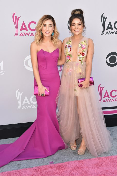 LAS VEGAS, NV - APRIL 02:  Recording artists Maddie Marlow (L) and Taylor 'Tae' Dye of music group Maddie & Tae attend the 52nd Academy Of Country Music Awards at Toshiba Plaza on April 2, 2017 in Las Vegas, Nevada.  (Photo by John Shearer/WireImage)