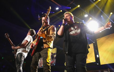 AUSTIN, TX - MAY 06:  Singer Gary LeVox (R), Joe Don Rooney (L) and Jay DeMarcus (C) of Rascal Flatts perform onstage during the 2017 iHeartCountry Festival, A Music Experience by AT&T at The Frank Erwin Center on May 6, 2017 in Austin, Texas.  (Photo by Christopher Polk/Getty Images for iHeartMedia  )