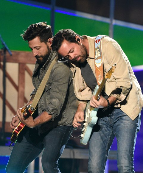 AUSTIN, TX - MAY 06:  Musicians Matthew Ramsey (L) and Brad Tursi of Old Dominion perform onstage during the 2017 iHeartCountry Festival, A Music Experience by AT&T at The Frank Erwin Center on May 6, 2017 in Austin, Texas.  (Photo by C Flanigan/Getty Images)
