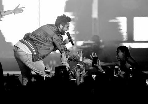 INDIO, CA - APRIL 30:  (EDITORS NOTE: This image has been converted to black and white.)  Singer Thomas Rhett performs on the Toyota Mane Stage during day 3 of 2017 Stagecoach California's Country Music Festival at the Empire Polo Club on April 30, 2017 in Indio, California.  (Photo by Kevin Winter/Getty Images for Stagecoach)