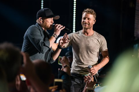 NASHVILLE, TN - JUNE 08:  (EDITORIAL USE ONLY) Singers Cole Swindell (L) and Dierks Bentley (R) perform at Nissan Stadium during day 1 of the 2017 CMA Music Festival on June 8, 2017 in Nashville, Tennessee.  (Photo by Richard Gabriel Ford/Getty Images)