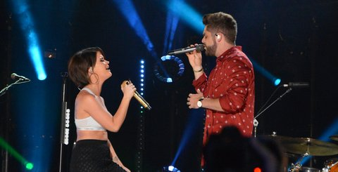 NASHVILLE, TN - JUNE 10:  (EDITORIAL USE ONLY)  Singer/songwriters Thomas Rhett (L) and Maren Morris perform at Nissan Stadium during day 3 of the 2017 CMA Music Festival on June 10, 2017 in Nashville, Tennessee.  (Photo by Mindy Small/FilmMagic)