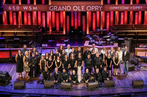 NASHVILLE, TN - JUNE 27: ACM,Vanderbilt,and Grand Ole Opry Staff and Board members join singer-songwriter Chris Young and AMC music campers on stage during the ACM Lifting Lives Music Camp Performance with Chris Young at Grand Ole Opry House on June 27, 2017 in Nashville, Tennessee.  (Photo by Terry Wyatt/Getty Images for Academy of Country Music)