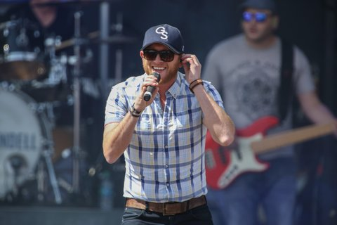 INDIANAPOLIS, IN - APRIL 05:  Cole Swindell performs onstage during the Capital One JamFest at the NCAA March Madness Music Festival ? Day 3 at White River State Park  on April 5, 2015 in Indianapolis, Indiana.  (Photo by Tasos Katopodis/Getty Images for Turner)