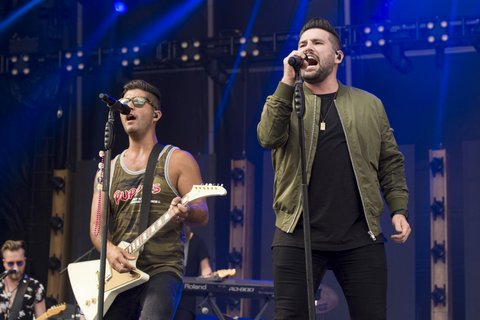 BROOKLYN, MI - JULY 22:  Dan Smyers (L) and Shay Mooney of Dan + Shay perform during Faster Horses Festival at Michigan International Speedway on July 22, 2017 in Brooklyn, Michigan.  (Photo by Erika Goldring/WireImage)