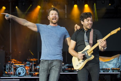 BROOKLYN, MI - JULY 23:  Brett Eldredge (L) and Greg Carrillo perform during Faster Horses Festival at Michigan International Speedway on July 23, 2017 in Brooklyn, Michigan.  (Photo by Erika Goldring/WireImage)