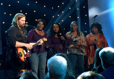 NASHVILLE, TN - AUGUST 24:  Chris Stapleton (L) and Alfreda McCrary, Regina McCrary, Deborah McCrary, and Ann McCrary of The McCrary Sisters perform onstage during Skyville Live Presents a Tribute to Jerry Lee Lewis on August 24, 2017 in Nashville, Tennessee.  (Photo by Rick Diamond/Getty Images for Skyville)