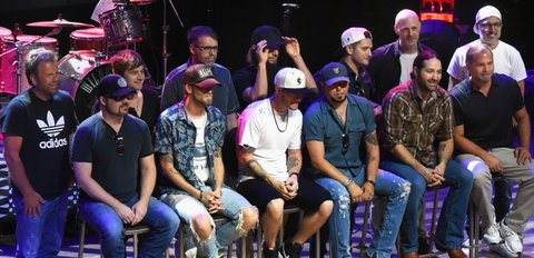 NASHVILLE, TN - AUGUST 02:  Sitting L/R: Singer/Songwriters - Deric Ruttan, Brian Kelley, Tyler Hubbard, Jason Aldean, Josh Thompson and Producer Michael Knox. Standing L/R: Singer/Songwriters - Wendell Mobley, Jimmy Robbins, Tony Martin, Brad Warren, Jordan Schmidt, Jerry Flowers and Brett Warren attend Jason Aldean's Triple #1 Party at Wildhorse Saloon on August 2, 2017 in Nashville, Tennessee.  (Photo by Rick Diamond/Getty Images)