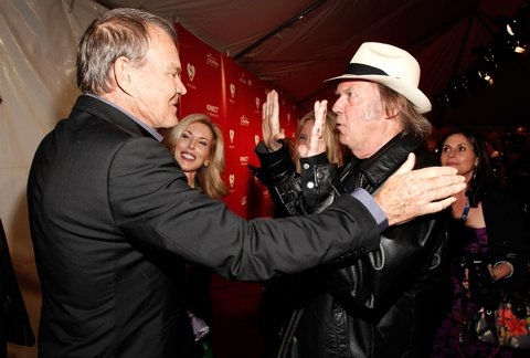 LOS ANGELES, CA - FEBRUARY 10:  Musicians Glen Campbell (L) and Neil Young arrive at The 2012 MusiCares Person of The Year Gala Honoring Paul McCartney at Los Angeles Convention Center on February 10, 2012 in Los Angeles, California.  (Photo by Christopher Polk/WireImage)