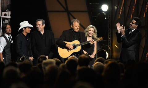 NASHVILLE, TN - NOVEMBER 09:  Keith Urban, Brad Paisley, Jimmy Webb, Glen Campbell, Kim Campbell, and Vince Gill receive a standing ovation at the 45th annual CMA Awards at the Bridgestone Arena on November 9, 2011 in Nashville, Tennessee.  (Photo by Frederick Breedon IV/FilmMagic)