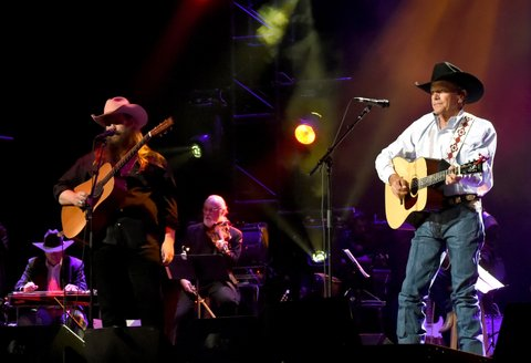 SAN ANTONIO, TX - SEPTEMBER 12:  Chris Stapleton (L) and George Strait perform onstage during George Strait's Hand in Hand Texas benefit concert; Strait and special guests Miranda Lambert, Chris Stapleton, Lyle Lovett and Robert Early Keen perform in concert at the Majestic Theatre on September 12, 2017 in San Antonio, Texas.  (Photo by Rick Diamond/Getty Images for George Strait)