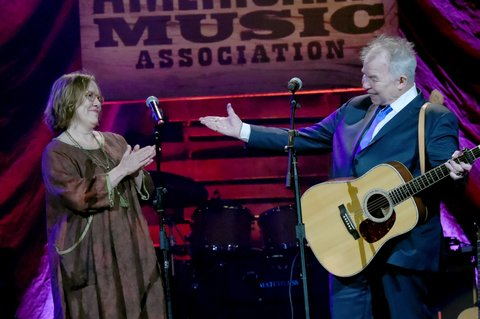 NASHVILLE, TN - SEPTEMBER 13:  Iris DeMent and John Prine perform onstage during the 2017 Americana Music Association Honors & Awards  on September 13, 2017 in Nashville, Tennessee.  (Photo by Rick Diamond/Getty Images for Americana Music)