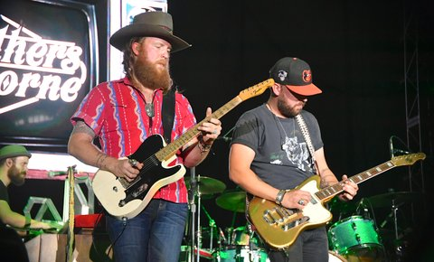 LAS VEGAS, NV - SEPTEMBER 29:  John Osborne (L) and T.J. Osborne of the Brothers Osborne perform during the Route 91 Harvest country music festival at the Las Vegas Village on September 29, 2017 in Las Vegas, Nevada.  (Photo by Mindy Small/FilmMagic)