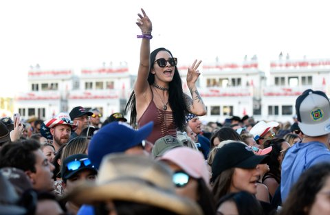 LAS VEGAS, NV - SEPTEMBER 30:  Fans cheers during the Route 91 Harvest country music festival at the Las Vegas Village on September 30, 2017 in Las Vegas, Nevada.  (Photo by David Becker/Getty Images)