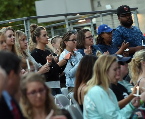 NASHVILLE, TN - OCTOBER 02: People gather during a candlelight vigil for victims of the Las Vegas shooting at Ascend Amphitheater on October 2, 2017 in Nashville, Tennessee.  Late Sunday night, a lone gunman, Stephan Paddock, 64, of Mesquite, Nevada, opened fire on attendees at the Route 91 Harvest Festival, a three-day country music festival, leaving at least 59 dead and over 500 injured before killing himself.  The massacre is one of the deadliest mass shooting events in U.S. history.  (Photo by Rick Diamond/Getty Images)