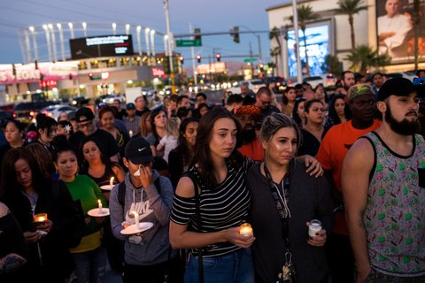 LAS VEGAS, NV - OCTOBER 2: Mourners attend a candlelight vigil at the corner of Sahara Avenue and Las Vegas Boulevard for the victims of Sunday night's mass shooting, October 2, 2017 in Las Vegas, Nevada. Late Sunday night, a lone gunman killed more than 50 people and injured more than 500 people after he opened fire on a large crowd at the Route 91 Harvest Festival, a three-day country music festival. The massacre is one of the deadliest mass shooting events in U.S. history. (Photo by Drew Angerer/Getty Images)