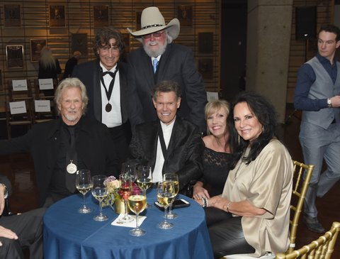 NASHVILLE, TN - OCTOBER 22:  Kris Kristofferson, Richard Sterban, Charlie Daniels, Randy Travis, Donna Sterban, and Mary Davis  attend the Medallion Ceremony to celebrate 2017 hall of fame inductees Alan Jackson, Jerry Reed And Don Schlitz at Country Music Hall of Fame and Museum on October 22, 2017 in Nashville, Tennessee.  (Photo by Rick Diamond/Getty Images for Country Music Hall Of Fame & Museum)