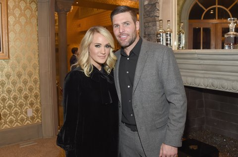 BRENTWOOD, TN - OCTOBER 24:  Singer-songwriter Carrie Underwood (L) and NHL Player Mike Fisher (R) attend Nashville Shines for Haiti benefiting Sean Penn's J/P Haitian relief organization featuring Tim McGraw hosted and underwritten by Johnathon Arndt and Newman Arndt at the Arndt Estate on October 24, 2017 in Brentwood, Tennessee.  (Photo by Rick Diamond/Getty Images for J/P Haitian Relief Organization)