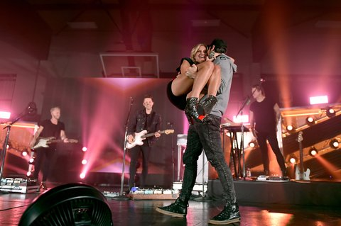 KNOXVILLE, TN - OCTOBER 28:  Morgan Evans surprises Kelsea Ballerini onstage while performing for Central High School presented by the Tennessee Department of Tourist Development on October 28, 2017 in Knoxville, Tennessee.  (Photo by John Shearer/Getty Images for Tennessee Department of Tourist Development)
