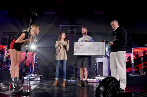 KNOXVILLE, TN - OCTOBER 28:  Kelsea Ballerini, iHeart Radio and The ACM's donate money to Central High School during her concert by the Tennessee Department of Tourist Development on October 28, 2017 in Knoxville, Tennessee.  (Photo by John Shearer/Getty Images for Tennessee Department of Tourist Development)