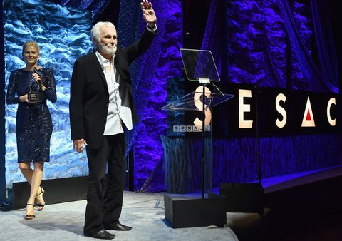 NASHVILLE, TN - NOVEMBER 05:  Vice President of Creative Services for SESAC Shannan Hatch and Legacy Award recipient Kenny Rogers stand onstage during the 2017 SESAC Nashville Music Awards on November 5, 2017 in Nashville, Tennessee.  (Photo by Jason Davis/Getty Images for SESAC)