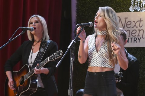 NASHVILLE, TN - NOVEMBER 07:  Singer-songwriters Ashlee Hewitt (L) and Whitney Duncan (R) of musical group Post Monroe perform onstage duriing the 2017 CMT Next Women Of Country Celebration at City Winery Nashville on November 7, 2017 in Nashville, Tennessee.  (Photo by Rick Diamond/Getty Images for CMT)