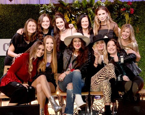 NASHVILLE, TN - NOVEMBER 07:  (Back Row L-R) Songwriter Erin Enderlin, singer-songwriters Bailey Bryan, Hannah Ellis, Hosts Senior Vice President of Music Strategy for CMT Leslie Fram, singer-songwriters Kassi Ashton and Jo Smith (Front Row L-R), Abby Anderson, Kalie Shorr, Alyssa Bonagura and Ruby Stewart of The Sisterhood Band and Ashley McBryde take photos during the 2017 CMT Next Women Of Country Celebration at City Winery Nashville on November 7, 2017 in Nashville, Tennessee.  (Photo by Rick Diamond/Getty Images for CMT)