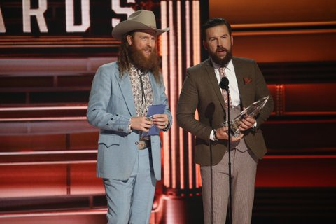 NASHVILLE, TN - NOVEMBER 08:  John Osborne and T.J. Osborne of Brothers Osborne accept an award onstage at the 51st annual CMA Awards at the Bridgestone Arena on November 8, 2017 in Nashville, Tennessee.  (Photo by Terry Wyatt/FilmMagic)