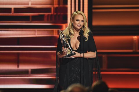 NASHVILLE, TN - NOVEMBER 08:  Miranda Lambert accepts an awarad onstage at the 51st annual CMA Awards at the Bridgestone Arena on November 8, 2017 in Nashville, Tennessee.  (Photo by John Shearer/WireImage)