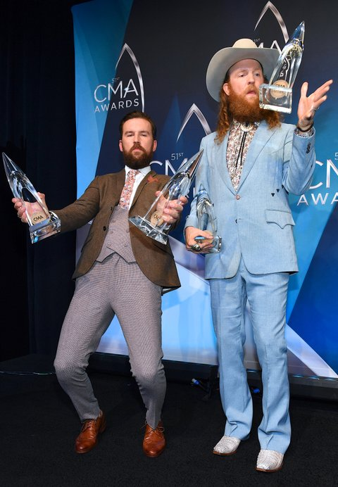 NASHVILLE, TN - NOVEMBER 08:  Recording Artists TJ. Osborne and John Osborne of Brothers Osborne celebrate winning Vocal Duo of the year during 51st annual CMA Awards at the Bridgestone Arena on November 8, 2017 in Nashville, Tennessee.  (Photo by Jason Davis/FilmMagic)