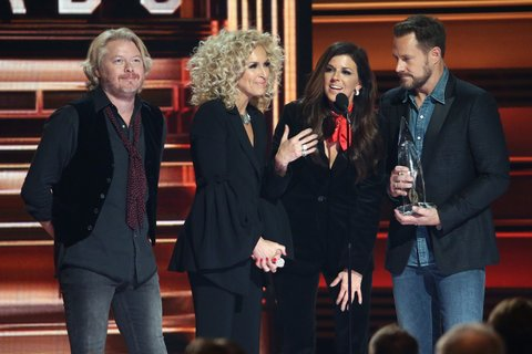 NASHVILLE, TN - NOVEMBER 08:  Philip Sweet, Kimberly Schlapman, Karen Fairchild, and Jimi Westbrook of Little Big Town accept an award onstage during the 51st annual CMA Awards at the Bridgestone Arena on November 8, 2017 in Nashville, Tennessee.  (Photo by Terry Wyatt/FilmMagic)