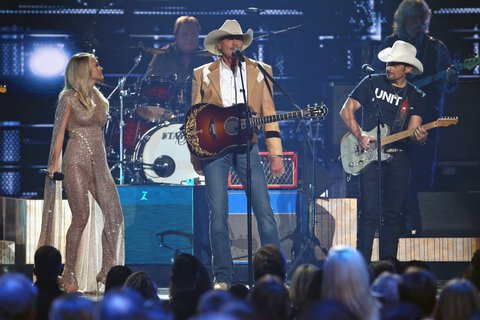NASHVILLE, TN - NOVEMBER 08:  Carrie Underwood, Alan Jackson and Brad Paisley perform onstage during the 51st annual CMA Awards at the Bridgestone Arena on November 8, 2017 in Nashville, Tennessee.  (Photo by Terry Wyatt/FilmMagic)